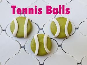 Tennis balls with label Dog bakery kirkland redmond bellevue sammamish dog cake dog bakery barkery booboo barkery prim and pawper dog treats dog cookies scampers